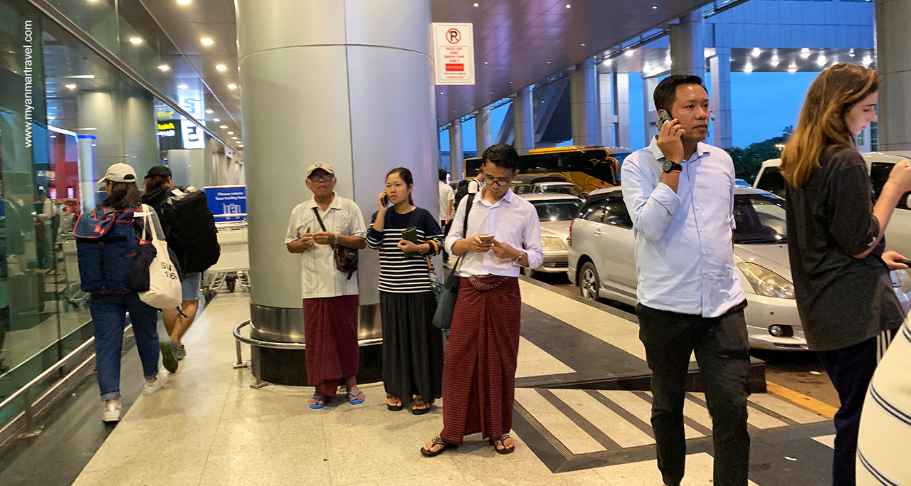 Take a taxi outside of arrival departure at Yangon international airport